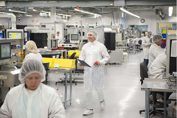 Man Walking Through Cleanroom manufacturing of medical devices