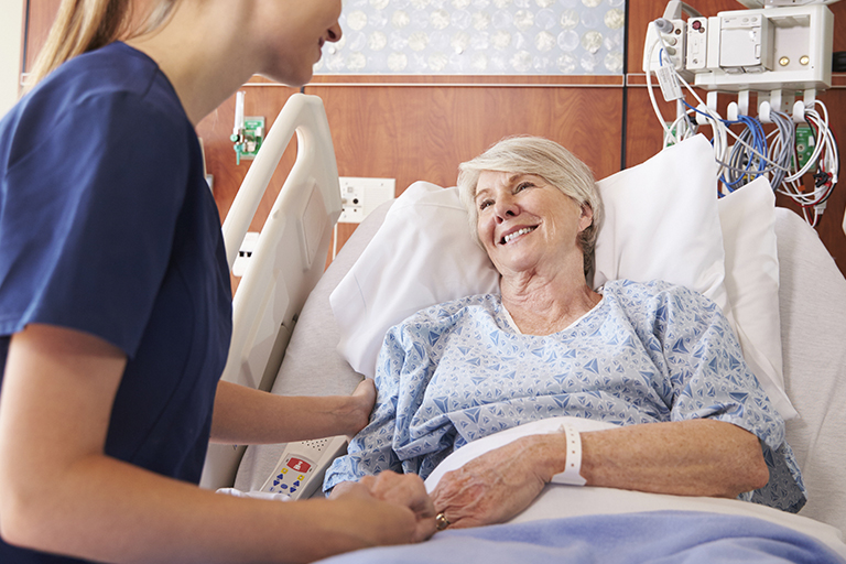 Patient Comfort Solutions Woman In Hospital Bed