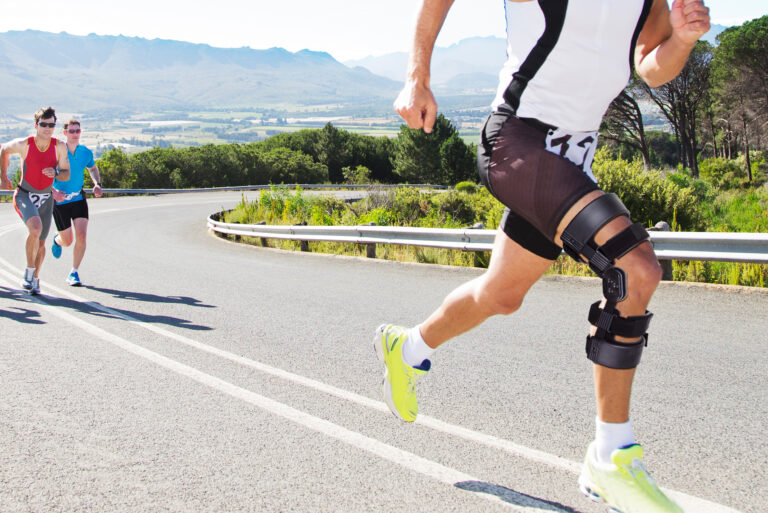 Man Running With Knee Brace On